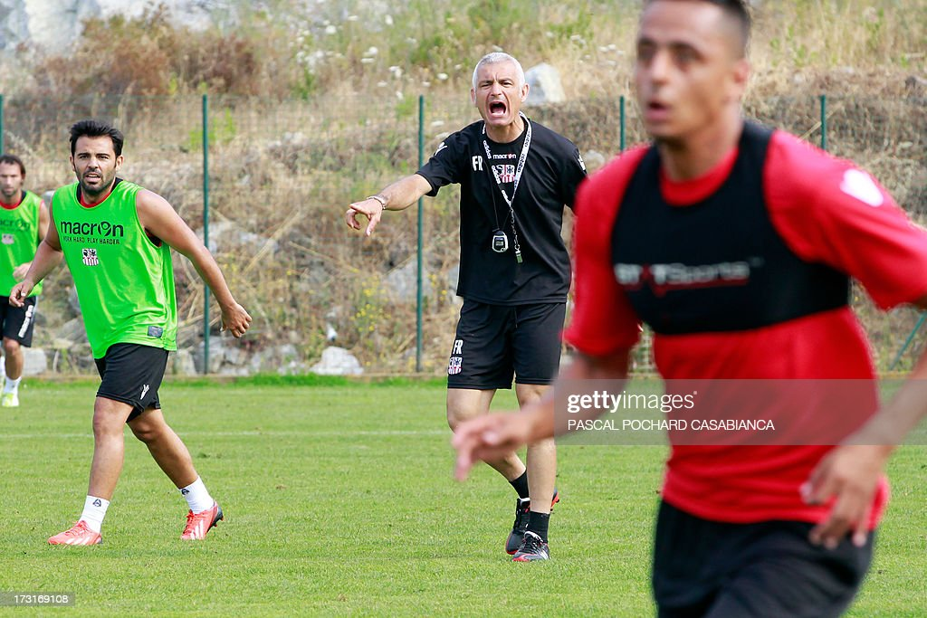 Ajaccio's L1 football club head coach, Italy's Fabrizio Ravanelli (C) attends a training session on July 9, 2013 in Ajaccio, French Mediterranean island of Corsica. AFP PHOTO / PASCAL POCHARD-CASABIANCA