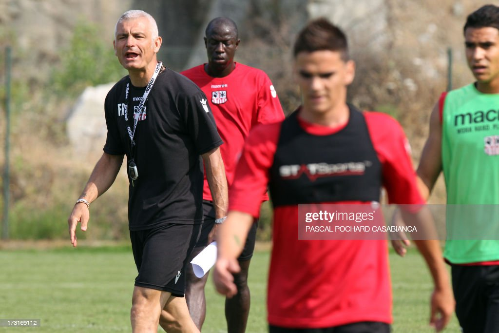 Ajaccio's L1 football club head coach, Italy's Fabrizio Ravanelli (L) attends a training session on July 9, 2013 in Ajaccio, French Mediterranean island of Corsica.