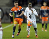Ajaccio's Malian forward Sigamary Diarra vies for the ball with Montpellier's French forward Anthony Mounier during the French L1 football match...