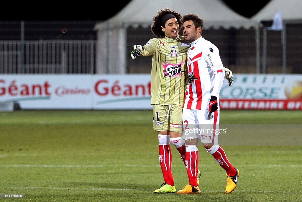 Ajaccio's Mexican goalkeeper Guillermo Ochoa and Romanian forward Adrian Mutu talk at the end of a French L1 football match between Ajaccio (ACA) and Bordeaux (GDB) at Francois Coty stadium in Ajaccio, Corsica, on February 9 , 2013.