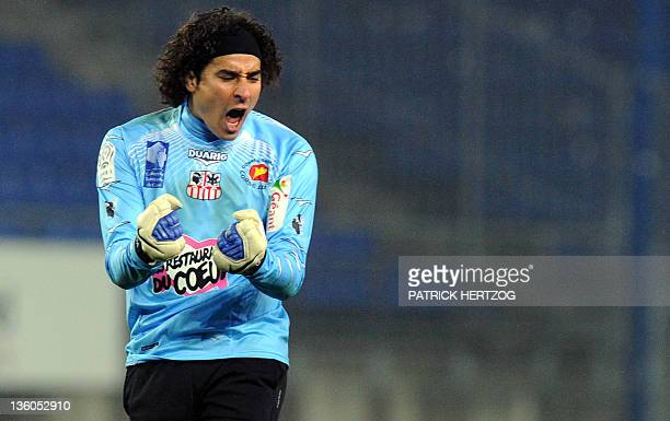 Ajaccio's Mexican goalkeeper Guillermo Ochoa celebrates the second goal for his team during the French L1 football match Sochaux vs Ajaccio on...