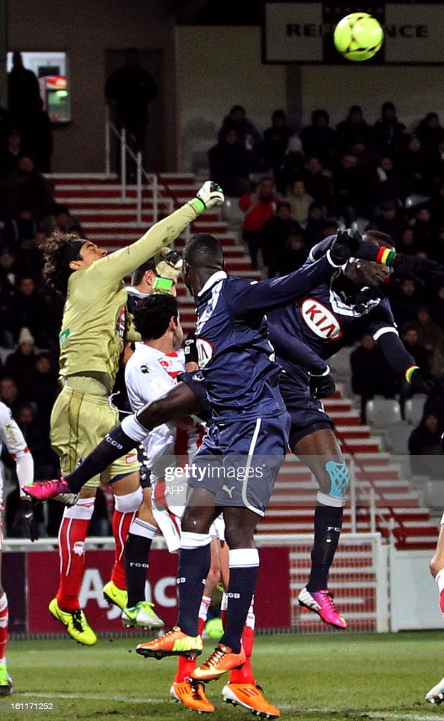 Ajaccio's Mexican goalkeeper Guillermo Ochoa (L) clears the ball during a French L1 football match between Ajaccio (ACA) and Bordeaux (GDB) at Francois Coty stadium in Ajaccio, Corsica, on February 9 , 2013.