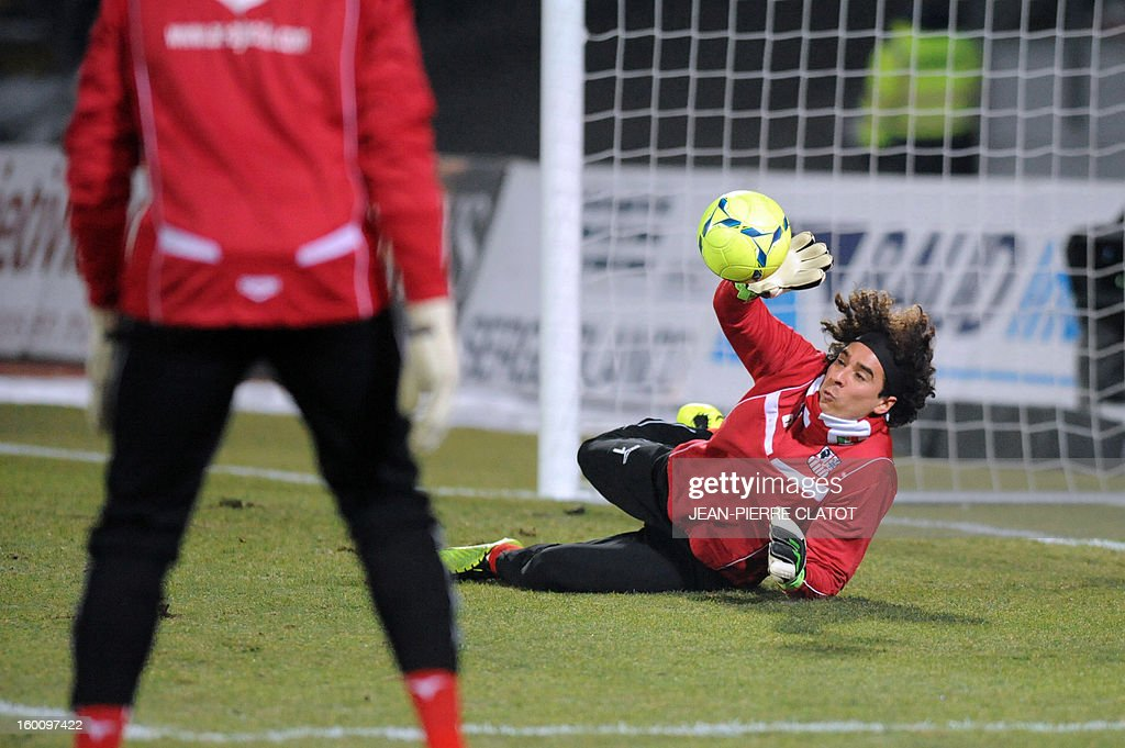 Ajaccio's Mexican goalkeeper Guillermo Ochoa deflects the ball before the French L1 football match Evian (ETGFC) vs Ajaccio (ACA) on January 26, 2013 at the Parc des Sports stadium in Annecy, eastern France.