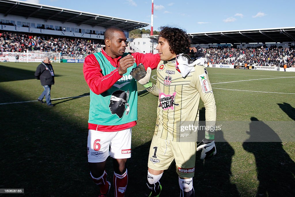 Ajaccio's Mexican goalkeeper Guillermo Ochoa is congratulated by French midfielder Ronald Zubar after winning the French L1 football match Ajaccio (ACA) vs Lyon (OL) in the Francois Coty stadium in Ajaccio, French Mediterranean island of Corsica, on February 3, 2013. Ajaccio won 3-1.