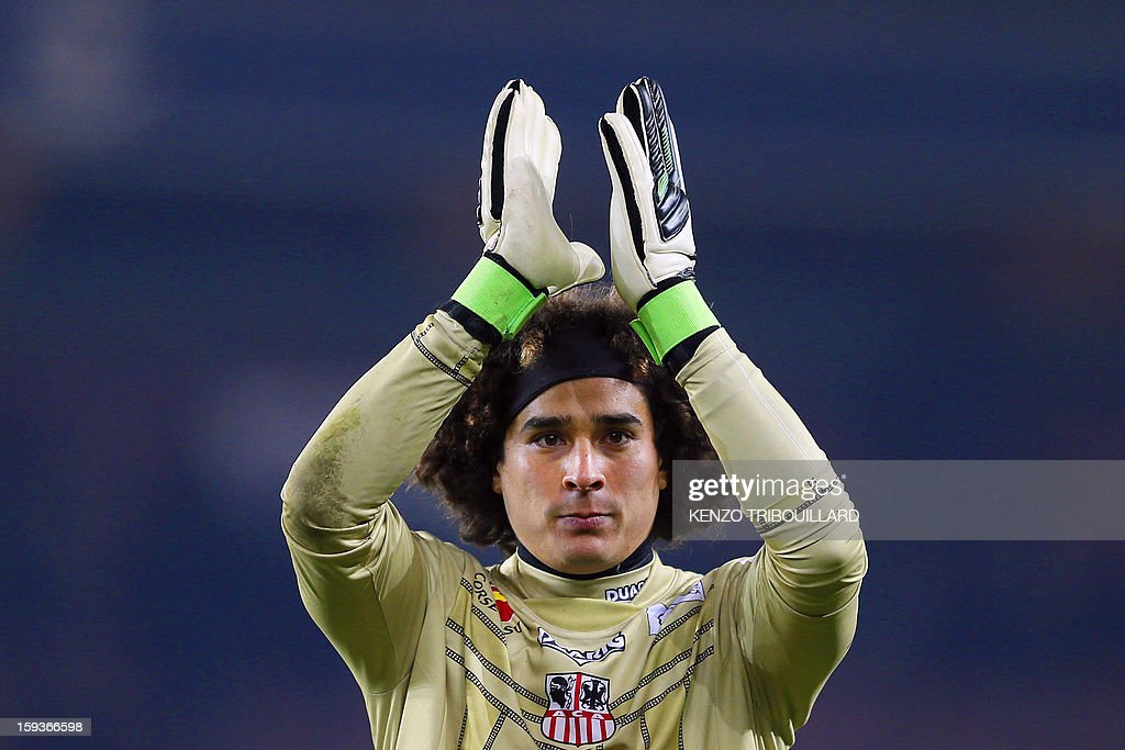 Ajaccio's Mexican goalkeeper <a gi-track='captionPersonalityLinkClicked' href=/galleries/search?phrase=Guillermo+Ochoa&family=editorial&specificpeople=490875 ng-click='$event.stopPropagation()'>Guillermo Ochoa</a> reacts after the French L1 football match Paris Saint-Germain (PSG) vs Ajaccio (ACA) on January 11, 2013 at the Parc des Princes stadium, in Paris.