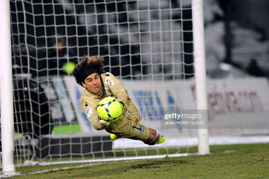 Ajaccio's Mexican goalkeeper Guillermo Ochoa stops a shoot during the French L1 football match Evian (ETGFC) vs Ajaccio (ACA) on January 26, 2013 at the city stadium Parc des sports in Annecy, eastern France.