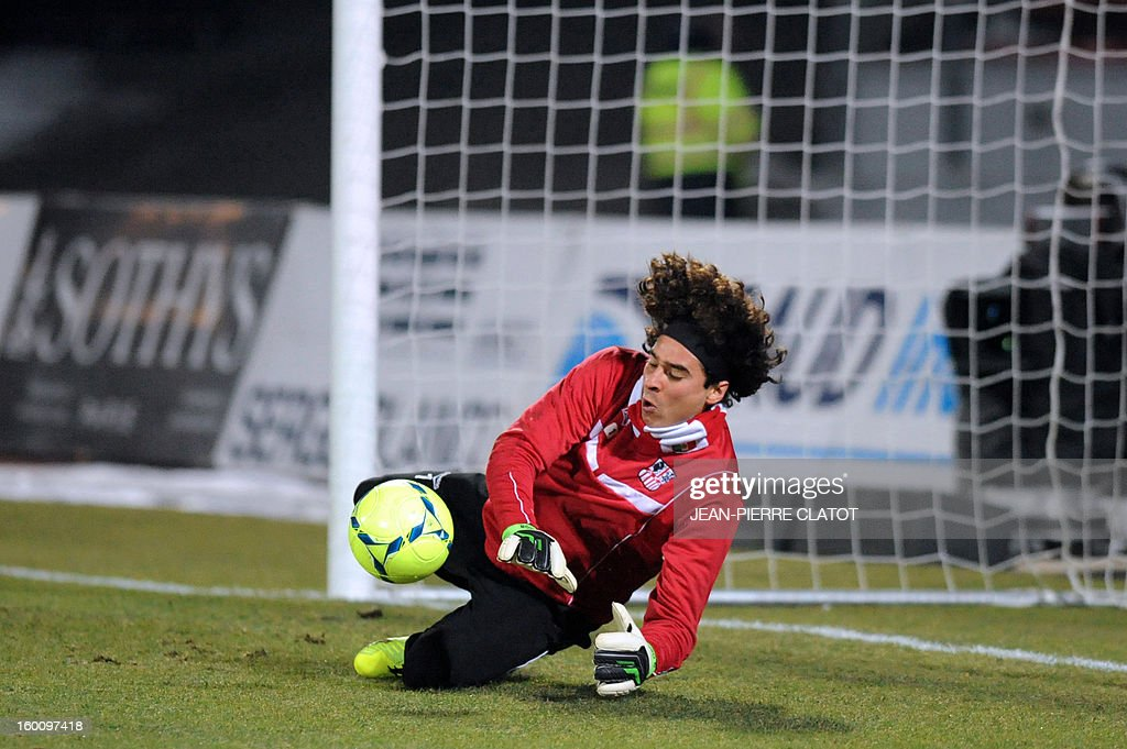 Ajaccio's Mexican goalkeeper Guillermo Ochoa stops the ball before the French L1 football match Evian (ETGFC) vs Ajaccio (ACA) on January 26, 2013 at the Parc des Sports stadium in Annecy, eastern France.