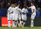 Ajaccio's midfielder Benoit Pedretti is congratulated by teammates after scoring a goal during the French L1 football match between Paris...