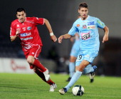 Ajaccio's Midfielder Paul Bastien Lasne vies with Nîmes's Miodrag Stosic during the French L2 football match Nîmes vs Ajaccio on May 27 2011 at the...