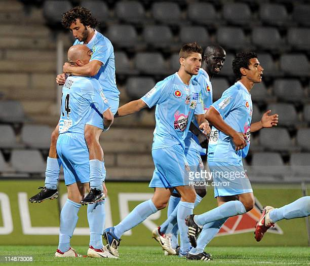 Ajaccio's players celebrate after scoring a goal during the French L2 football match Nîmes vs Ajaccio on May 27 2011 at the Costières stadium in...