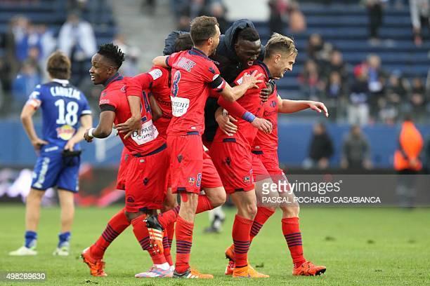 Ajaccio's players celebrate after winning the L1 football match Bastia against Gazelec Ajaccio on November 22 at the Armand Cesari stadium in Bastia...