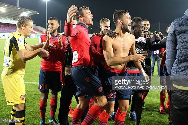 Ajaccio's players celebrate during the French L1 football match between Gazelec Ajaccio and Nice on October 24 at the Ange Casanova stadium in...