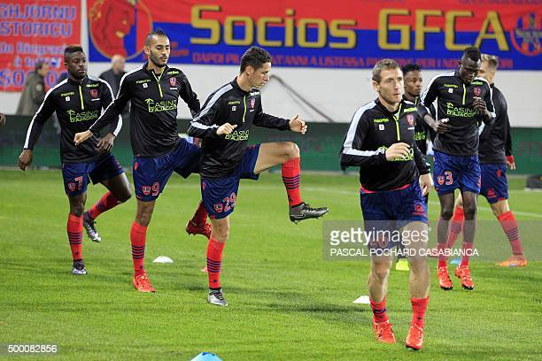 Ajaccio's players warm up before the L1 football match Gazelec Ajaccio against Nantes on December 5 at the Ange Casanova stadium in Ajaccio on the...