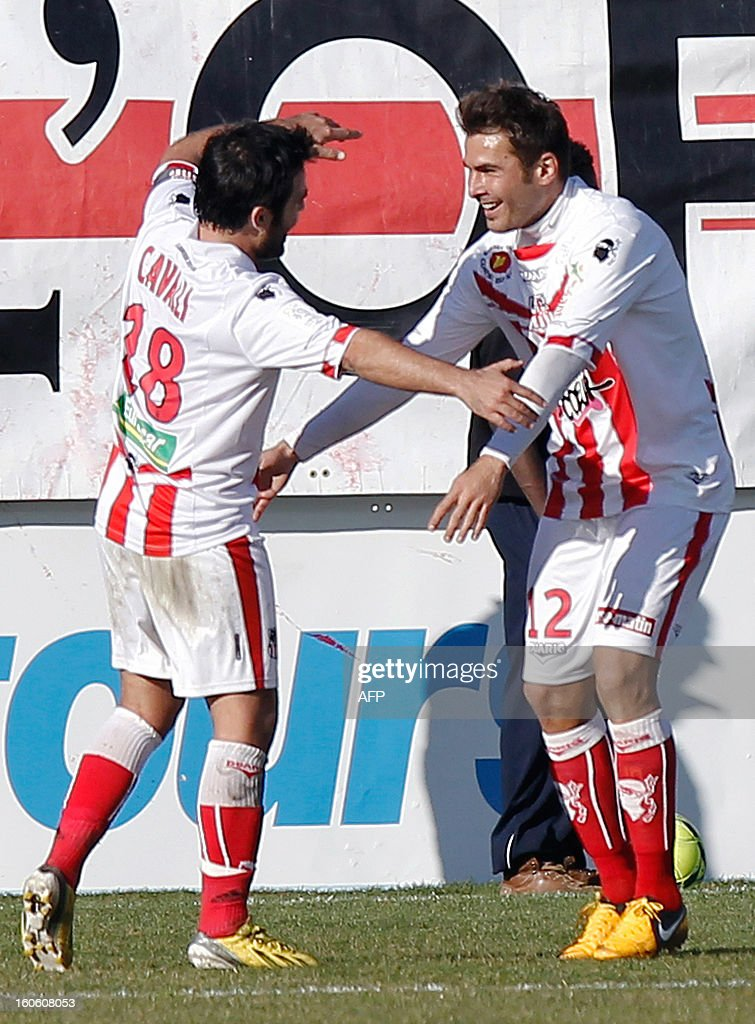 Ajaccio's Romanian forward Adrian Mutu (R) is congratulated by teammates after scoring a goal during the French L1 football match Ajaccio (ACA) vs Lyon (OL) in the Francois Coty stadium in Ajaccio, French Mediterranean island of Corsica, on February 3, 2013. AFP PHOTO / PASCAL POCHARD-CASABIANCA