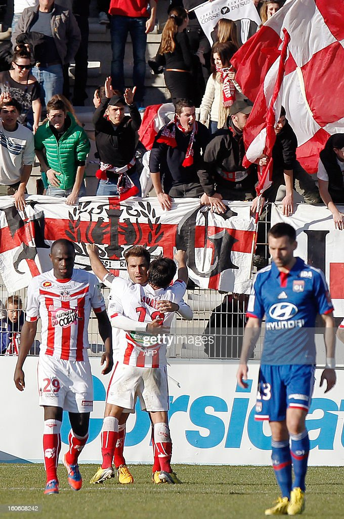 Ajaccio's Romanian forward Adrian Mutu (C) is congratulated by teammates after scoring a penalty during the French L1 football match Ajaccio (ACA) vs Lyon (OL) in the Francois Coty stadium in Ajaccio, French Mediterranean island of Corsica, on February 3, 2013. AFP PHOTO / PASCAL POCHARD-CASABIANCA