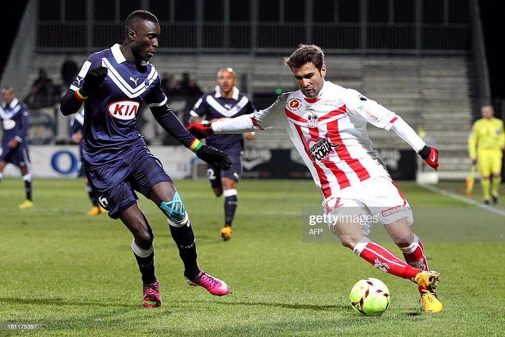 Ajaccio's Romanian forward Adrian Mutu (R) vies with Bordeaux's Senegalse defender Lamiane Sane during a French L1 football match between Ajaccio (ACA) and Bordeaux (GDB) at Francois Coty stadium in Ajaccio, Corsica, on February 9 , 2013. AFP PHOTO / PASCAL POCHARD-CASABIANCA