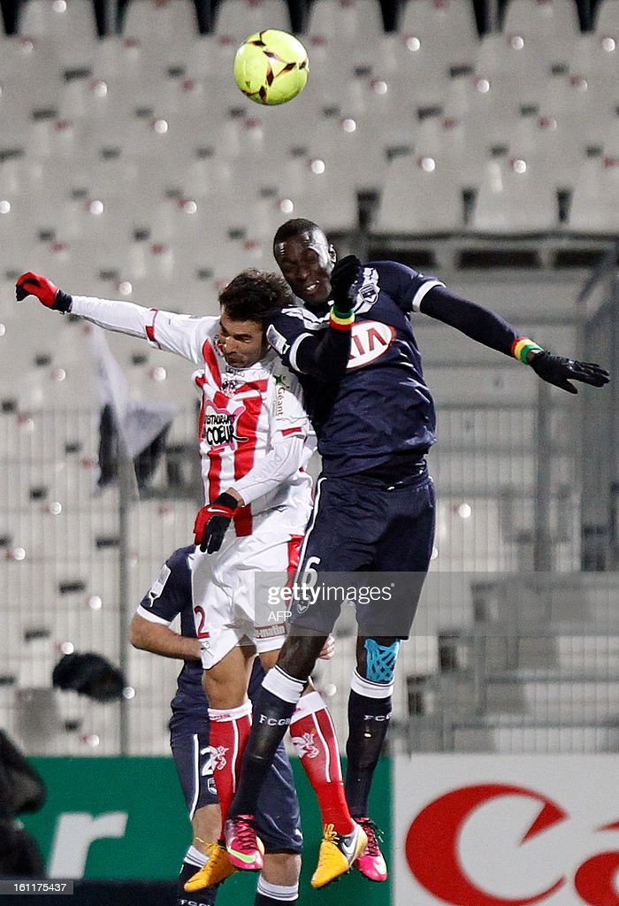 Ajaccio's Romanian forward Adrian Mutu (L) vies with Bordeaux's Senegalse defender Lamiane Sane during a French L1 football match between Ajaccio (ACA) and Bordeaux (GDB) at Francois Coty stadium in Ajaccio, Corsica, on February 9 , 2013.