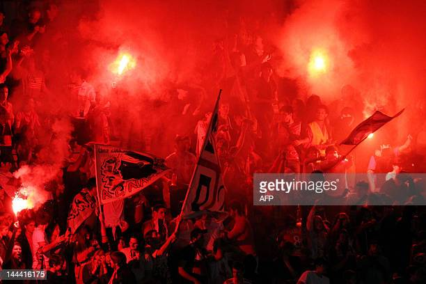 Ajaccio's supporters celebrate a goal during the French L1 football match Ajaccio vs Lyon in the Francois Coty stadium in Ajaccio Corsica on May 13...
