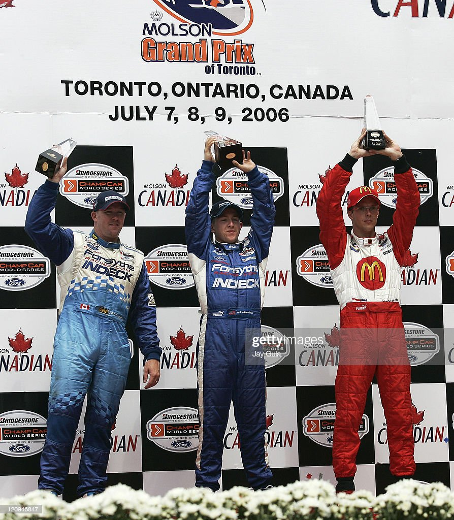A.J.Allmendinger(middle) <a gi-track='captionPersonalityLinkClicked' href=/galleries/search?phrase=Paul+Tracy&family=editorial&specificpeople=179458 ng-click='$event.stopPropagation()'>Paul Tracy</a>(L) and Sebastien Bourdais hoist their trophies after finishing 1st, 2nd, and 3rd respectively in the Grand Prix of Toronto at Exhibition Place in Toronto, Canada. July 9, 2006