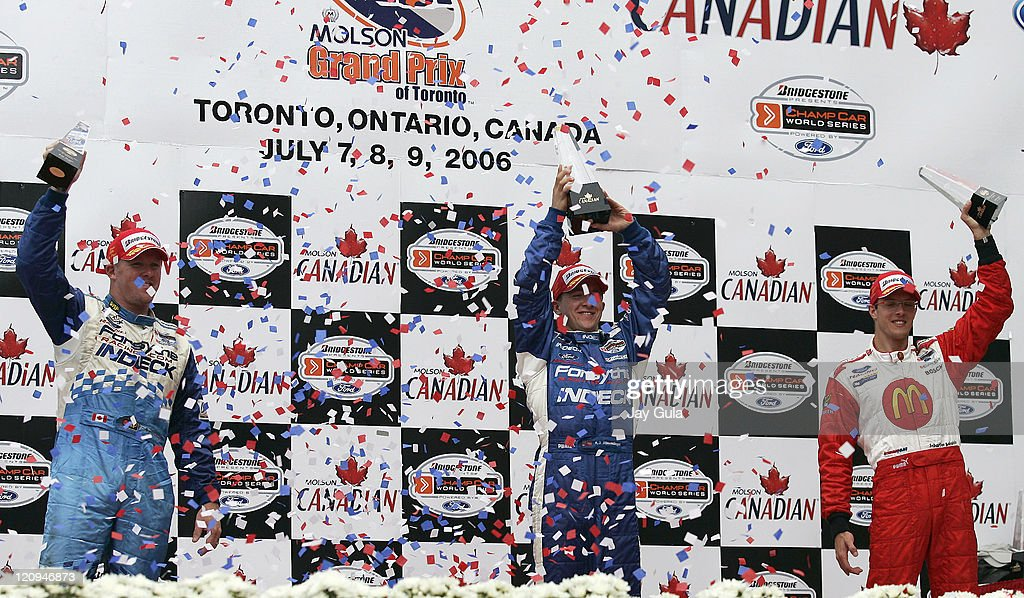 A.J.Allmendinger(middle) <a gi-track='captionPersonalityLinkClicked' href=/galleries/search?phrase=Paul+Tracy&family=editorial&specificpeople=179458 ng-click='$event.stopPropagation()'>Paul Tracy</a>(L) and Sebastien Bourdais hoist their trophies amid a confetti shower after finishing 1st, 2nd and 3rd respectively in the Grand Prix of Toronto at Exhibition Place in Toronto Canada. July 9, 2006