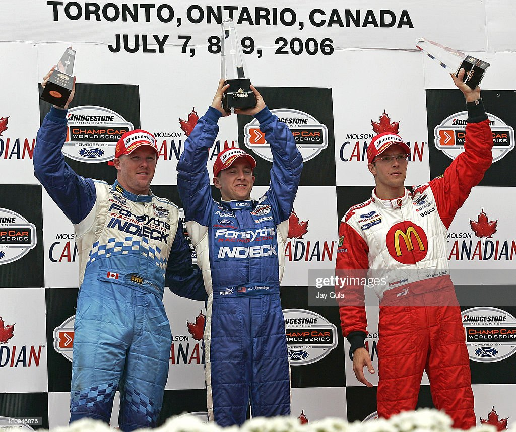 A.J.Allmendinger(middle) <a gi-track='captionPersonalityLinkClicked' href=/galleries/search?phrase=Paul+Tracy&family=editorial&specificpeople=179458 ng-click='$event.stopPropagation()'>Paul Tracy</a>(L) and Sebastien Bourdais hoist their trophies after finishing 1st, 2nd and 3rd respectively in the Grand Prix of Toronto at Exhibition Place in Toronto Canada. July 9, 2006