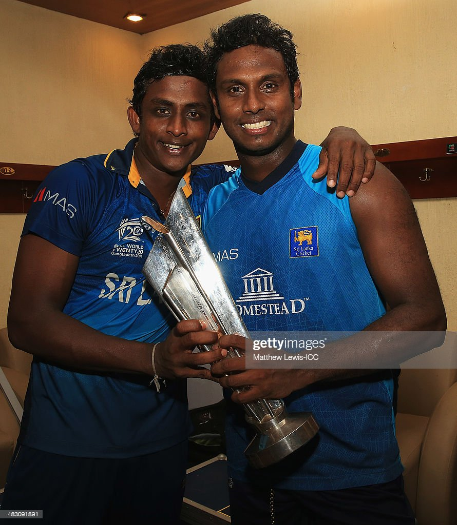 <a gi-track='captionPersonalityLinkClicked' href=/galleries/search?phrase=Ajantha+Mendis&family=editorial&specificpeople=5123004 ng-click='$event.stopPropagation()'>Ajantha Mendis</a> and <a gi-track='captionPersonalityLinkClicked' href=/galleries/search?phrase=Angelo+Mathews&family=editorial&specificpeople=5622021 ng-click='$event.stopPropagation()'>Angelo Mathews</a> of Sri Lanka celebrate winning the ICC World Twenty20 Bangladesh 2014 Final between India and Sri Lanka at Sher-e-Bangla Mirpur Stadium on April 6, 2014 in Dhaka, Bangladesh.