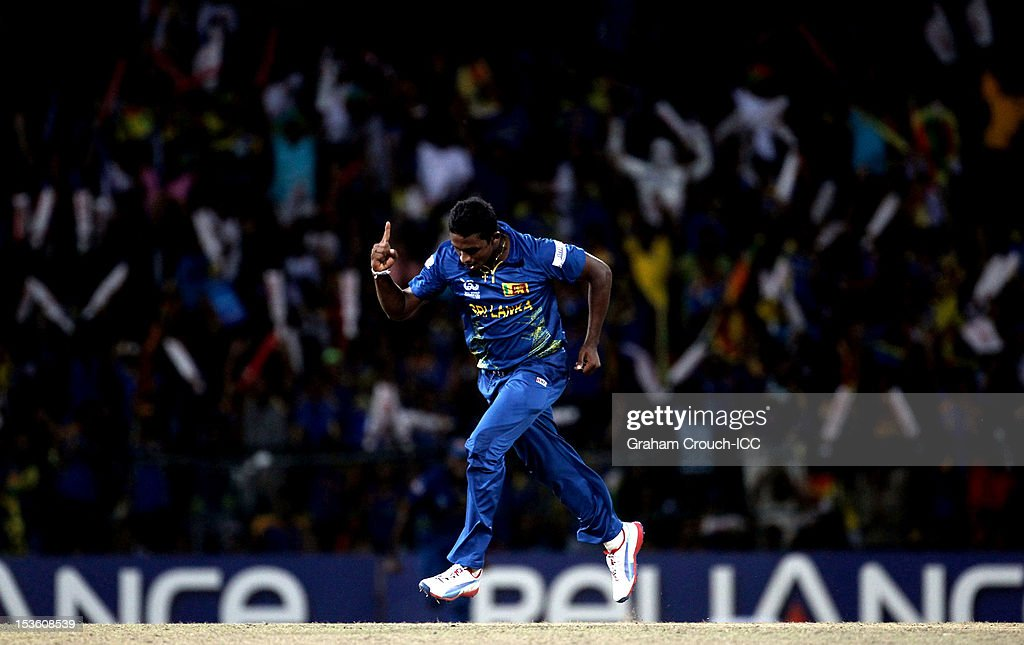 <a gi-track='captionPersonalityLinkClicked' href=/galleries/search?phrase=Ajantha+Mendis&family=editorial&specificpeople=5123004 ng-click='$event.stopPropagation()'>Ajantha Mendis</a> of Sri Lanka celebrates after trapping Chris Gayle of West Indies LBW during the ICC World Twenty20 2012 Final between Sri Lanka and West Indies at R. Premadasa Stadium on October 7, 2012 in Colombo, Sri Lanka.
