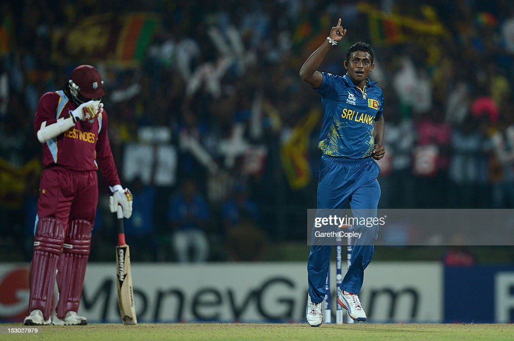 <a gi-track='captionPersonalityLinkClicked' href=/galleries/search?phrase=Ajantha+Mendis&family=editorial&specificpeople=5123004 ng-click='$event.stopPropagation()'>Ajantha Mendis</a> of Sri Lanka celebrates dismissing Johnson Charles of the West Indies during the ICC World Twenty20 2012 Super Eights Group 1 match between Sri Lanka and the West Indies at Pallekele Cricket Stadium on September 29, 2012 in Kandy, Sri Lanka.