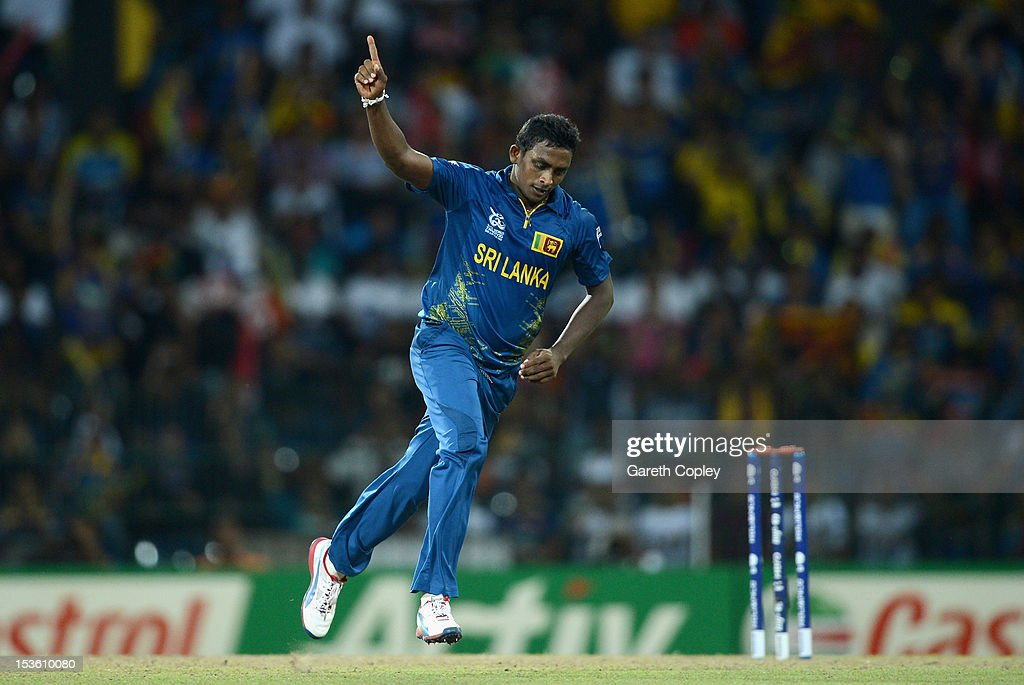 <a gi-track='captionPersonalityLinkClicked' href=/galleries/search?phrase=Ajantha+Mendis&family=editorial&specificpeople=5123004 ng-click='$event.stopPropagation()'>Ajantha Mendis</a> of Sri Lanka celebrates dismissing Kieron Pollard of the West Indies during the ICC World Twenty20 2012 Final between Sri Lanka and the West Indies at R. Premadasa Stadium on October 7, 2012 in Colombo, Sri Lanka.
