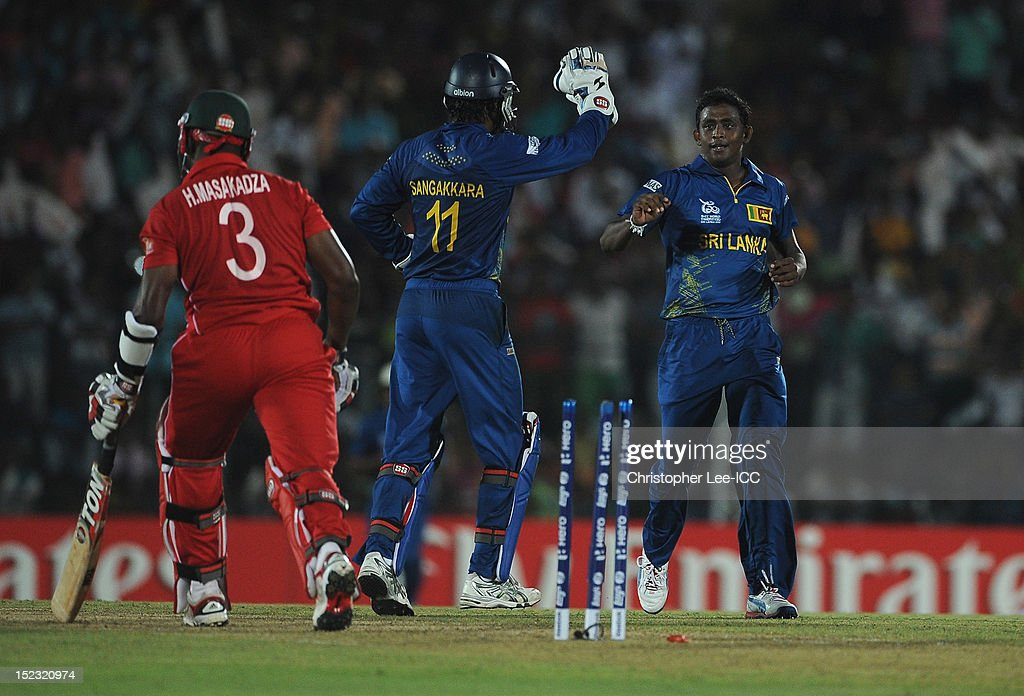 <a gi-track='captionPersonalityLinkClicked' href=/galleries/search?phrase=Ajantha+Mendis&family=editorial&specificpeople=5123004 ng-click='$event.stopPropagation()'>Ajantha Mendis</a> of Sri Lanka celebrates taking the wicket of <a gi-track='captionPersonalityLinkClicked' href=/galleries/search?phrase=Hamilton+Masakadza&family=editorial&specificpeople=824831 ng-click='$event.stopPropagation()'>Hamilton Masakadza</a> of Zimbabwe during the ICC World Twenty20 Cup Group C match between Sri Lanka and Zimbabwe at Mahinda Rajapaksa International Cricket Stadium on September 18, 2012 in Hambantota, Sri Lanka.