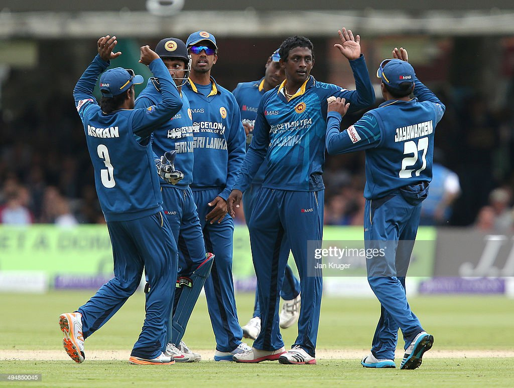 <a gi-track='captionPersonalityLinkClicked' href=/galleries/search?phrase=Ajantha+Mendis&family=editorial&specificpeople=5123004 ng-click='$event.stopPropagation()'>Ajantha Mendis</a> of Sri Lanka celebrates the wicket of Gary Balance of England during the 4th Royal London One Day International match between England and Sri Lanka at Lord's Cricket Ground on May 31, 2014 in London, England.