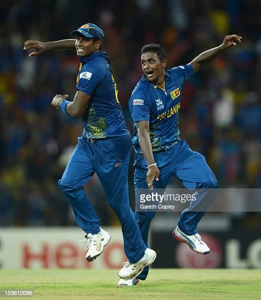 Ajantha Mendis of Sri Lanka celebrates with Lahiru Thirimanne after dismissing Kieron Pollard of the West Indies during the ICC World Twenty20 2012...