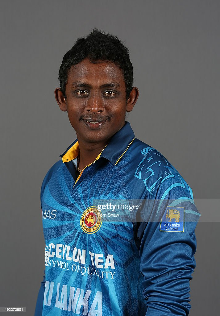 <a gi-track='captionPersonalityLinkClicked' href=/galleries/search?phrase=Ajantha+Mendis&family=editorial&specificpeople=5123004 ng-click='$event.stopPropagation()'>Ajantha Mendis</a> of Sri Lanka poses for a headshot during the Sri Lanka nets session at The Kia Oval on May 19, 2014 in London, England.