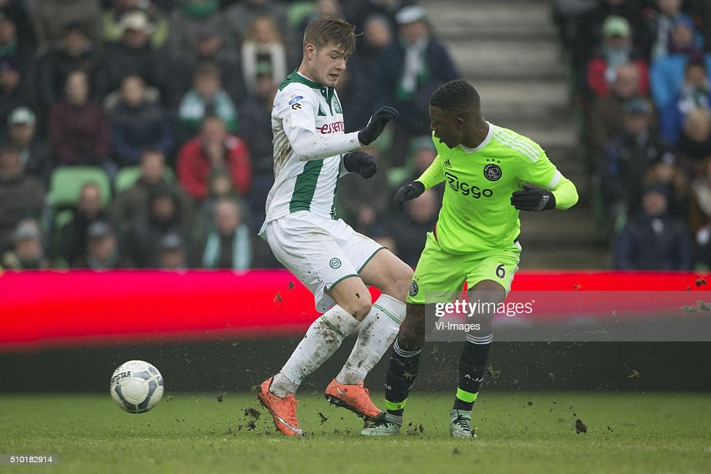 , Ajax, Alexander Sorloth of FC Groningen, Riechedly Bazoer of AFC Ajax, during the Dutch Eredivisie match between FC Groningen and Ajax Amsterdam at Euroborg on February 14, 2016 in Groningen, The Netherlands