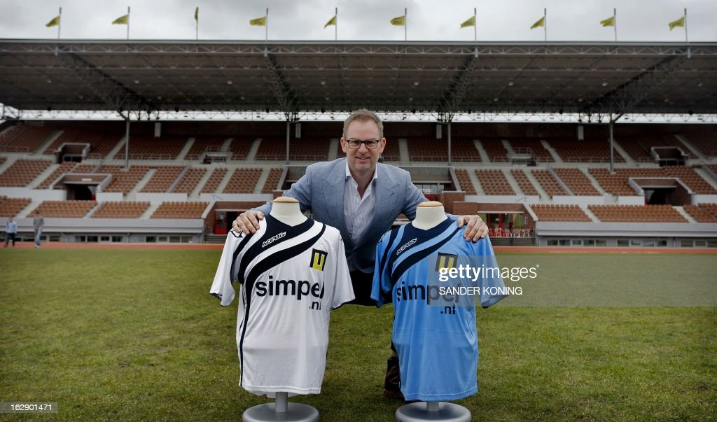 Ajax Amsterdam coach and former football player Ronald de Boer poses with the jerseys of the new club 'Men United' in Amsterdam on March 1, 2013. De Boer seeks the 24 best players, between the age of 16 and 20 years old, for his new team. The new football team will hold a selection of football talent from all over the Netherlands and will participate in the prestigious youth football tournament Aegon Copa Amsterdam. AFP PHOTO / ANP - SANDER KONING - netherlands out -