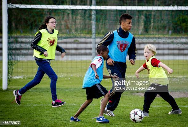 Ajax Amsterdam football club player Tobias Sana coaches children who need special education during the Ajax Aegon Sports Day at the Ronald McDonald...