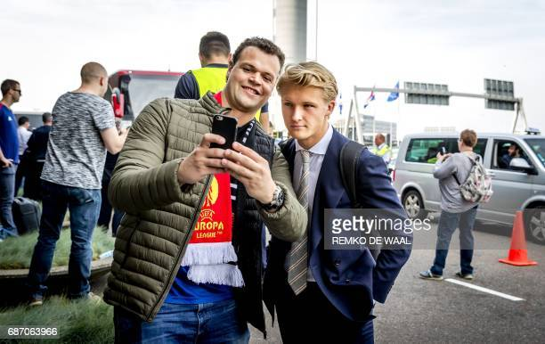 Ajax Amsterdam football club's player Kasper Dolberg poses for pictures at Schiphol Airport on May 23 before the team's departure to Stockholm on the...