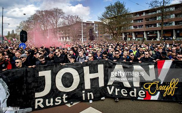 Ajax Amsterdam football club's supporters take part in a march to pay homage to late football player Johan Cruyff on April 3 2016 in Amsterdam Johan...