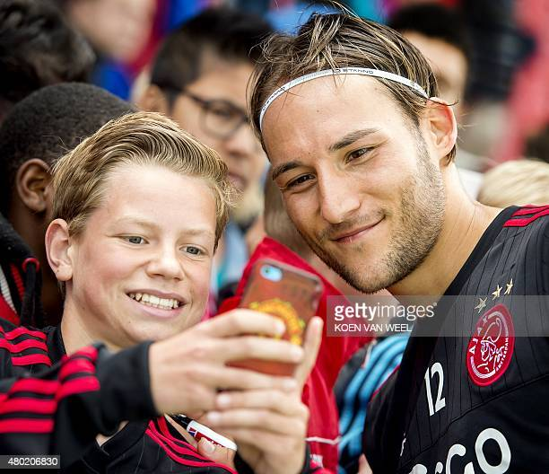 Ajax Amsterdam player Nemanja Gudelj poses for a photo with a fan during the public training at De Toekomst stadium in Amsterdam The Netherlands 09...