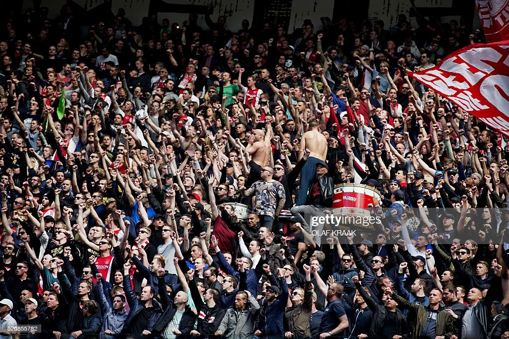 Ajax Amsterdam supporters celebrate after winning the league match 4-0 against FC Twente in Amsterdam, on May 1, 2016. / AFP / ANP / OLAF KRAAK / Netherlands OUT