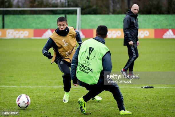 Ajax Amsterdam's Brazilian forward David Neres controls the ball during a training session in Amsterdam on February 22 2017 on the eve of the UEFA...