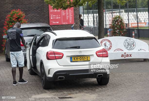 Ajax Amsterdam's Colombian footballer Davinson Sanchez prepares to get in a vehicle as he leaves the team training complex at De Toekomst in...