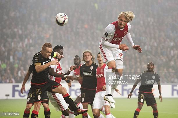 Ajax Amsterdam's Danish forward Kasper Dolberg heads the ball against Standard Liege during the UEFA Europa League group G football match in...