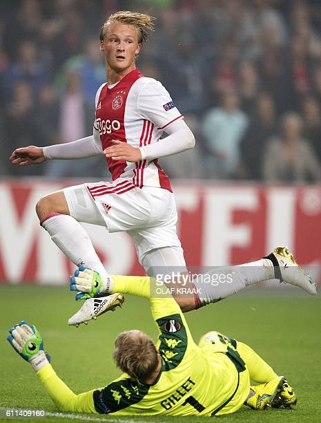 Ajax Amsterdam's Danish forward Kasper Dolberg jumps over Standard Liege goalkeeper JeanFrancois Gillet during the UEFA Europa League group G...