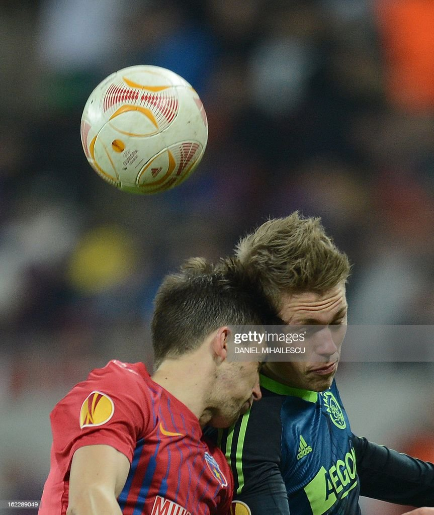 Ajax Amsterdam's Danish forward Viktor Fischer (R) vies for the ball with Bucharest's defender Cornel Rapa during the UEFA Europa League Round of 32 football match FC Steaua Bucuresti vs AFC Ajax in Bucharest, Romania on February 21, 2013.