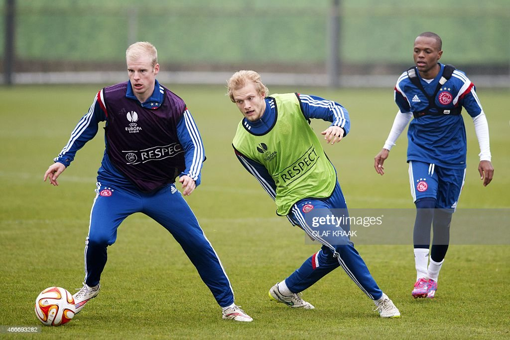 Ajax Amsterdam's (L-R) Davy Klaasen, <a gi-track='captionPersonalityLinkClicked' href=/galleries/search?phrase=Nicolai+Boilesen&family=editorial&specificpeople=7619083 ng-click='$event.stopPropagation()'>Nicolai Boilesen</a> and <a gi-track='captionPersonalityLinkClicked' href=/galleries/search?phrase=Thulani+Serero&family=editorial&specificpeople=6234374 ng-click='$event.stopPropagation()'>Thulani Serero</a> take part in a training session in Amsterdam on March 18, 2015 on the eve of the UEFA Europa League round of 16 football match between Ajax Amsterdam and Dnipro Dnipropetrovsk.
