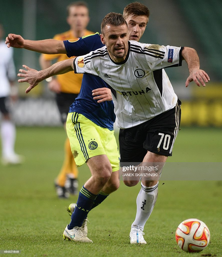 Ajax Amsterdam's Dutch defender Joel Veltman and Legia Warszawa's forward from Portugal Orlando vie for the ball during the round of 32 second leg...