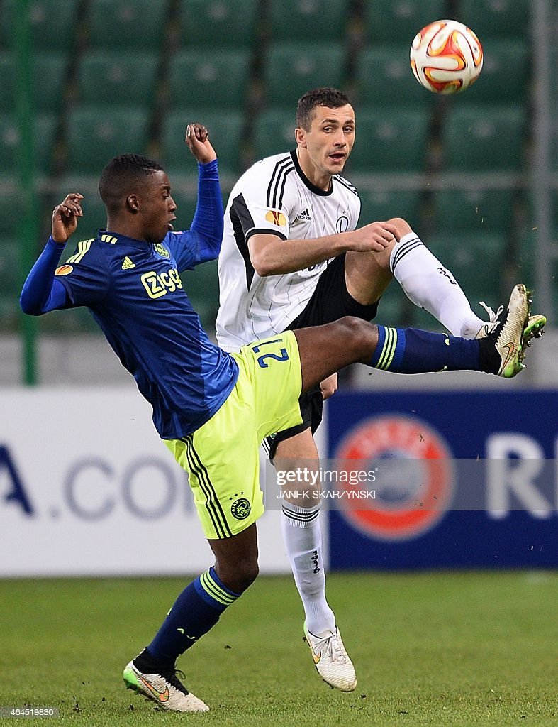 Ajax Amsterdam's Dutch forward Anwar El Ghazi vies for a ball with Legia Warszawa's defender <a gi-track='captionPersonalityLinkClicked' href=/galleries/search?phrase=Tomasz+Jodlowiec&family=editorial&specificpeople=5700915 ng-click='$event.stopPropagation()'>Tomasz Jodlowiec</a> during the round of 32, second leg UEFA Europe League football match Legia Warszawa vs AFC Ajax Amsterdam, in Warsaw, on February 26, 2015.