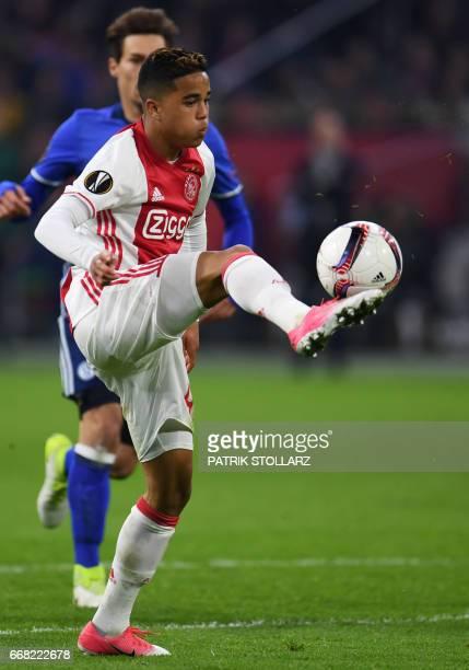 Ajax Amsterdam's Dutch striker Justin Kluivert controls the ball during the UEFA Europa League football match between Ajax Amsterdam and Schalke 04...