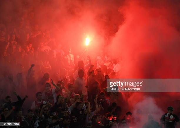 Ajax Amsterdam's fans light flares during the UEFA Europa League final football match Ajax Amsterdam v Manchester United on May 24 2017 at the...